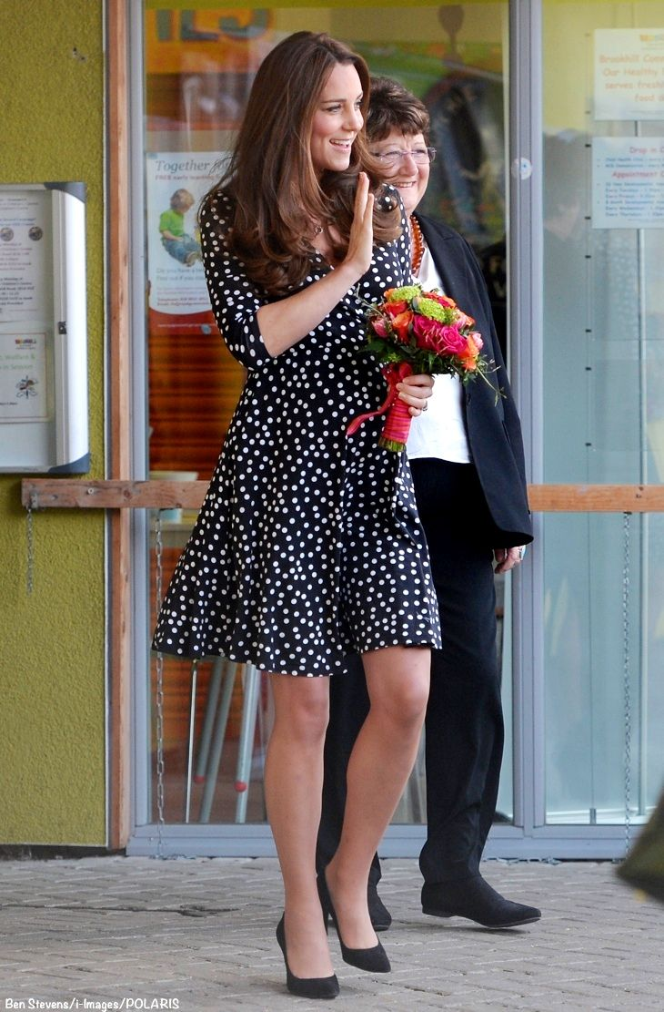Kate middleton visits brookhill childrens centre in londons kate middleton visits brookhill childrens centre in londons woolwich she wore an asos wrap skater maternity dress her mulberry bayswater clutch ombrellifo Gallery