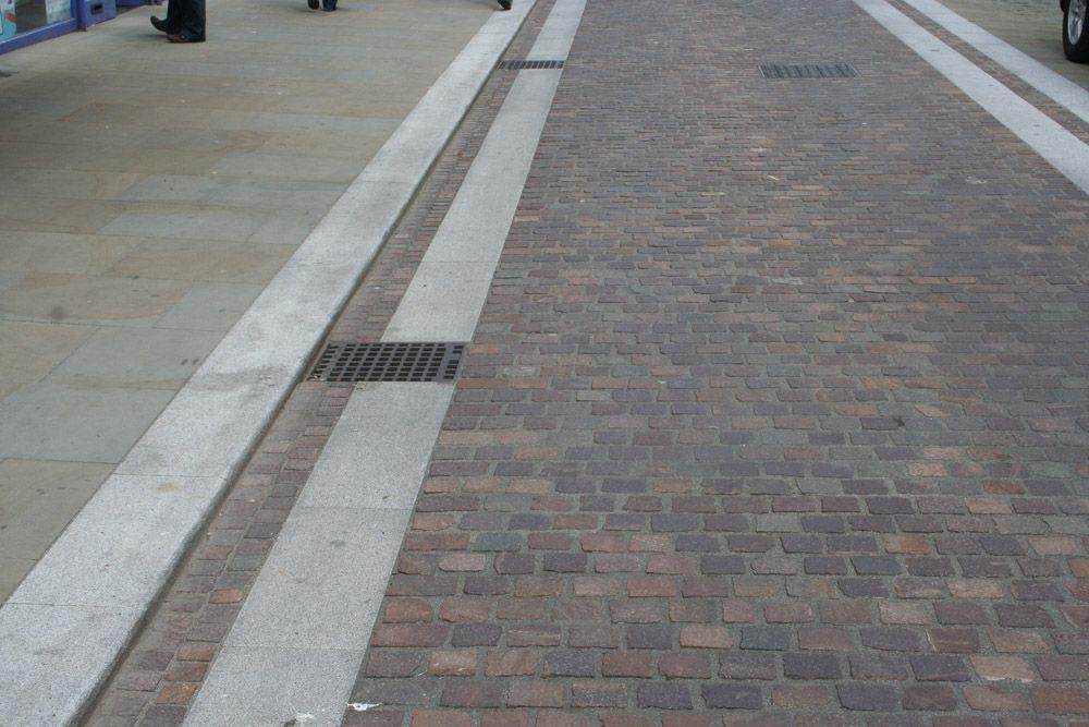 Widemarsh Street Sidewalk | Porphyry Setts | Silver Grey Granite Paving & Kerb