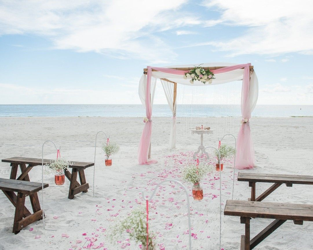 Simple florals and tones of pink Beach wedding planner