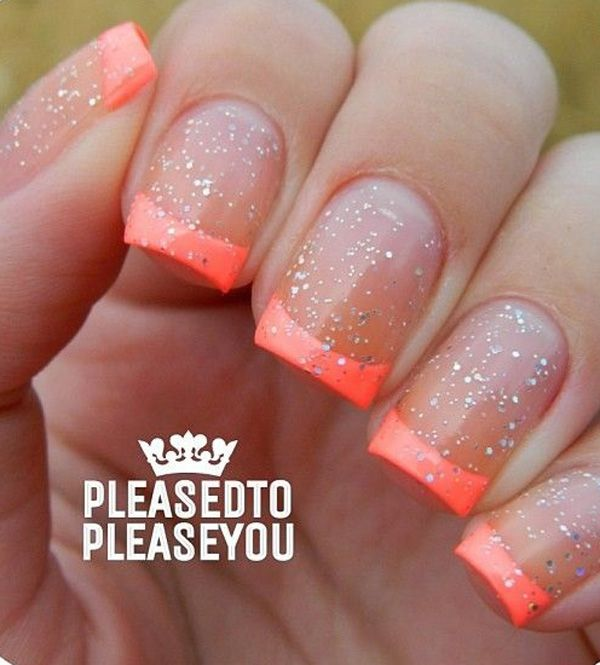 Summer inspired French tips. Dip your nails into neon orange French tips and emphasize the summer fun by adding silver glitter on top.
