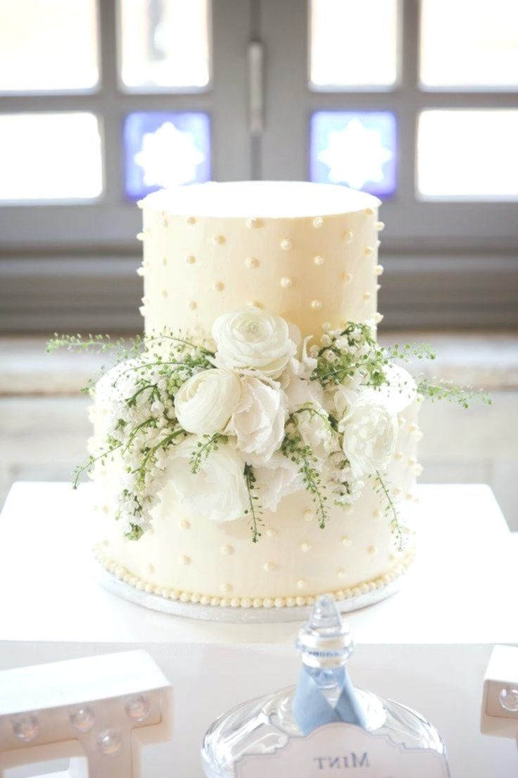 Beautiful classic two tier wedding cake with fresh white