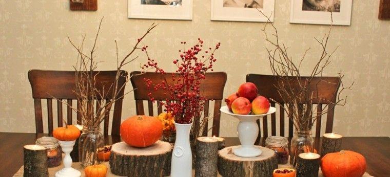 ramas de rbol y troncos de madera para decorar la mesa para una fiesta otoal