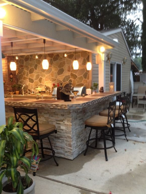 Our design features a matted quartzite wall stacked stone for Outdoor kitchen and patio ideas