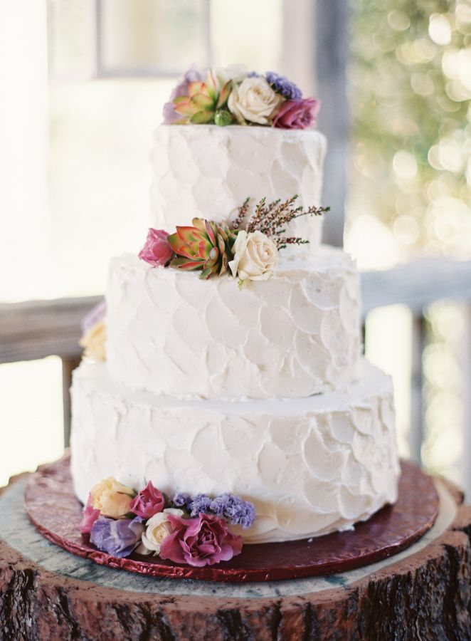 Bohemian floral topped wedding cake: http://www.stylemepretty.com/california-weddings/temecula/2015/11/04/whimsical-summer-wedding-at-temecula-creek-inn/ | Photography: Sposto Photography - http://spostophotography.com/