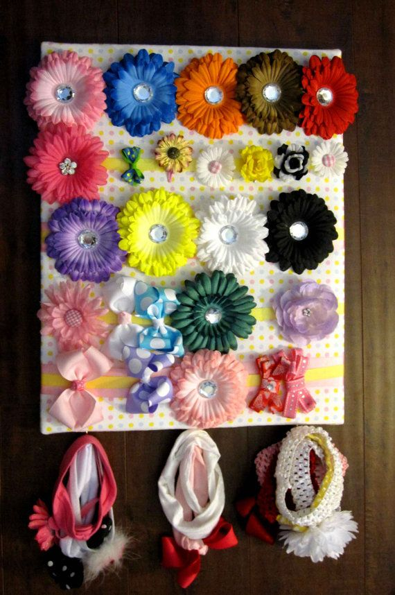 Bow Boards are a must have in any little girls room. they are the best way to keep you little ones bow and head bands organized and easy to find. $26.00    The bow boards measure 16x20 inch and have plenty of room for over 15 bows and head bands!    They come in any color combo and matched to your child's room decor!    add on headband holder for 3.00 extra! perfect for hanging your daughters headbands and keeping them all organized!    (certain bedding sets may have an up charge depending…