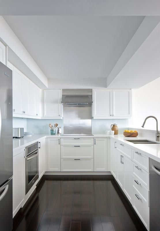 U-Shaped White Kitchen with Stainless Steel Appliances | Remodelista on white open kitchens, white island kitchens, white circular kitchens, white coastal kitchens, white corner kitchens, white small kitchens, white cottage style kitchens, white craftsman style kitchens, white black kitchens, white white kitchens, white kitchens with dark floors, white galley kitchens, white rectangular kitchens, white casual kitchens, white oak kitchens,