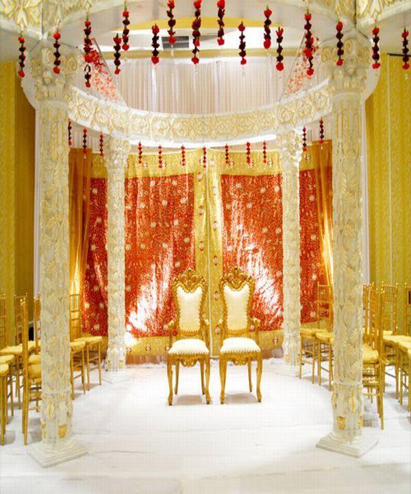 Impressive yellow mandap design Ceremony Spaces