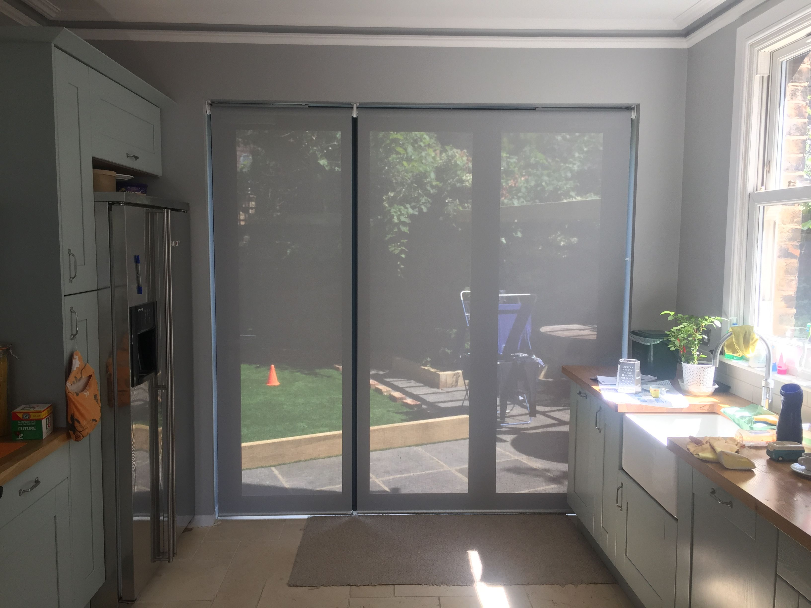 Sunscreen roller blinds for bifold doors | Electric remote control ...