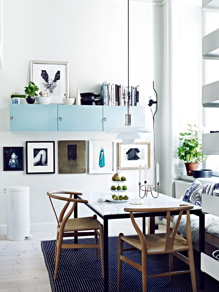 Jonas Ingerstedt\u0027s home Wishbone chair, Turquoise cabinets and