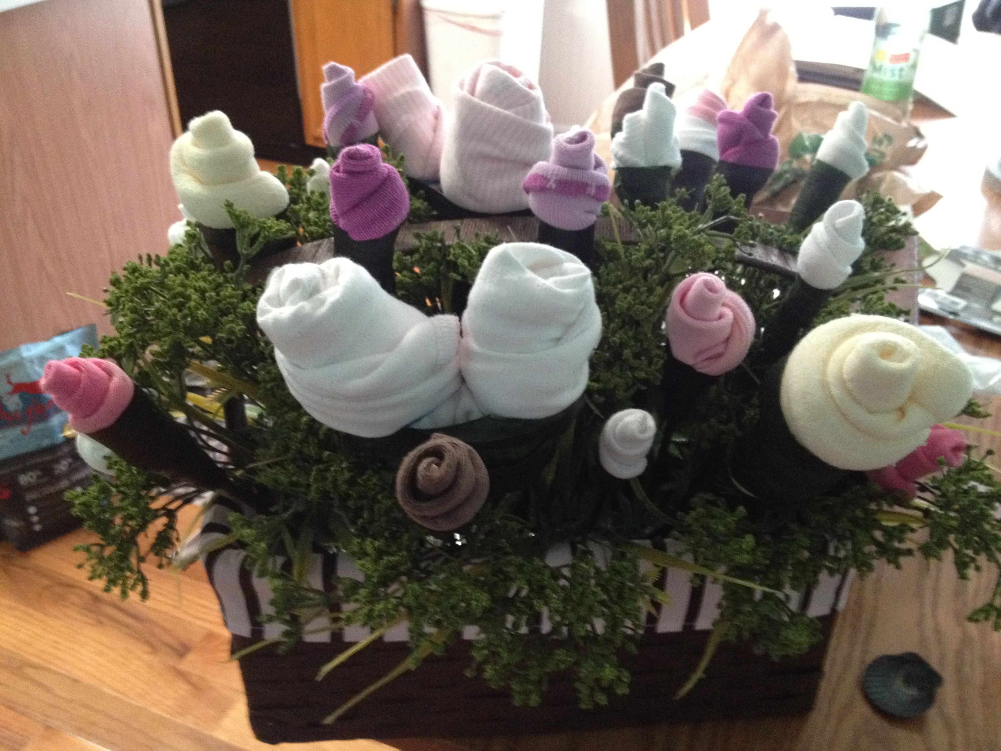 Baby Bouquet Made Out Of Socks Bibs And Gowns I Watched A Martha Stewart Tutorial On How To Make Them It Was SO Easy