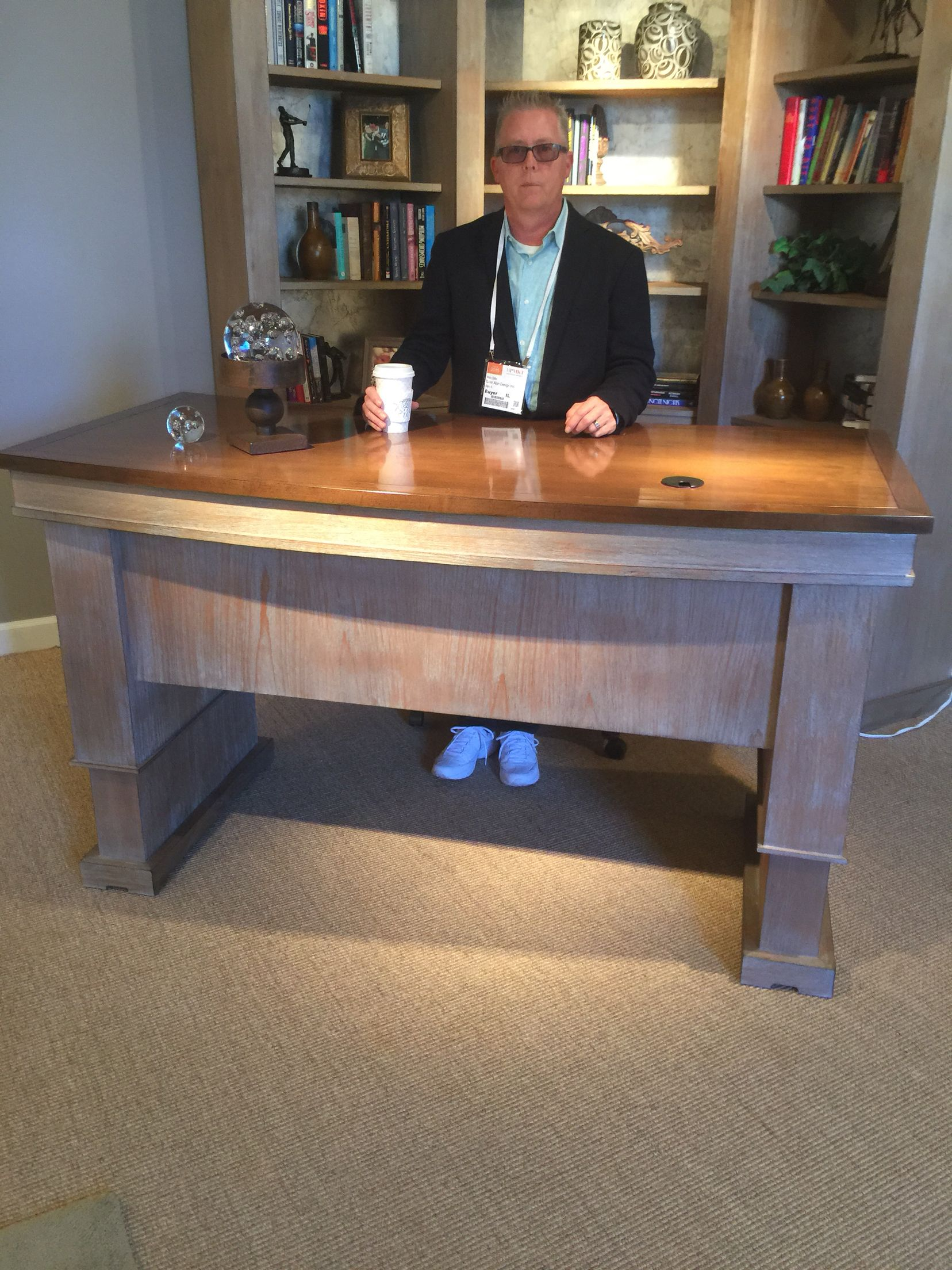 Sit down stand up desk with the push of a button the whole desk moves up and down