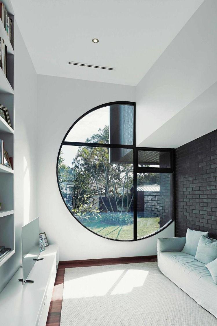 Wohnbereich mit rundem Fenster - Hawkstone St. House by steelehouse #architecture