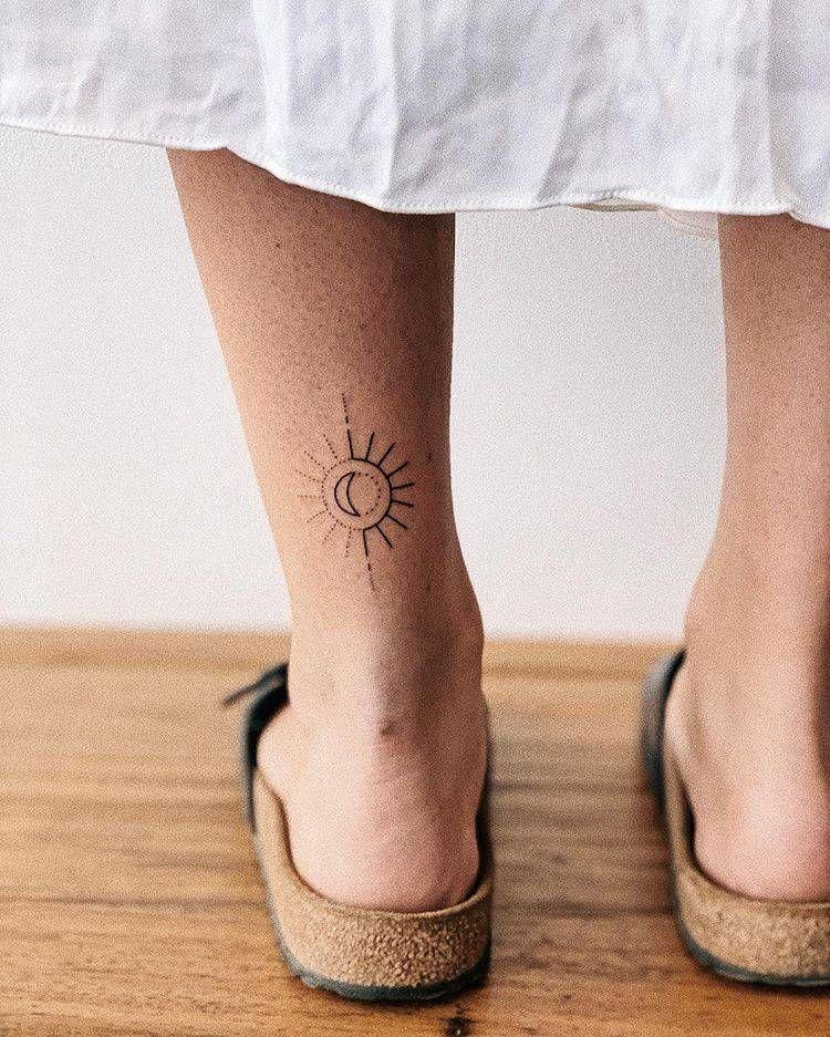 Hand poked sun and moon tattoo.