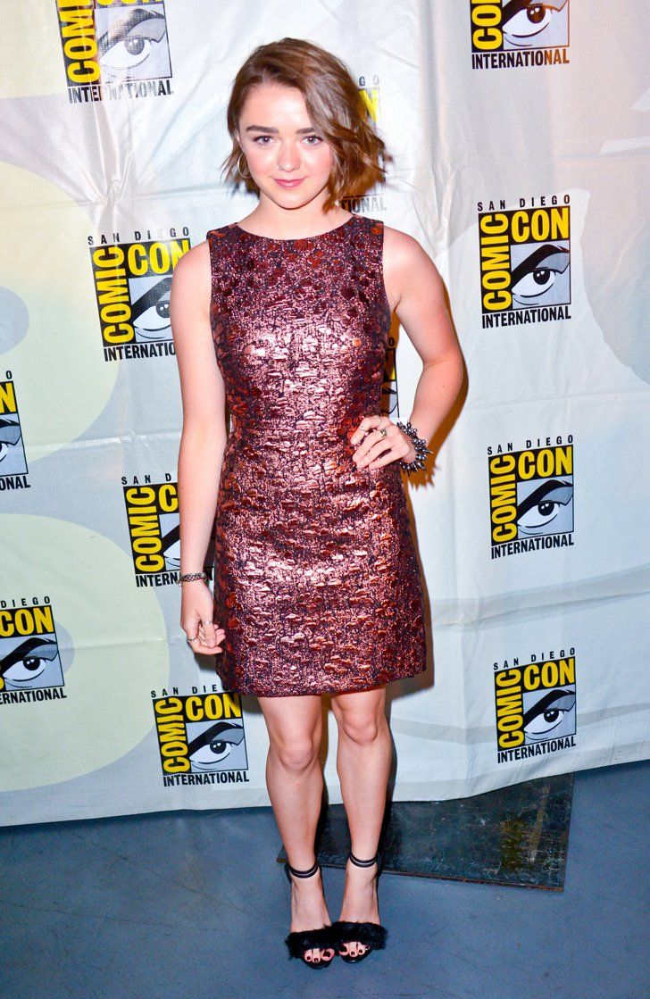 Pin for Later: 22 Times Maisie Williams's Teenage Wardrobe Was Cooler Than Yours  Sticking to a style she loves, the brocade mini, Maisie chose a slightly more wearable look for another Comic-Con engagement.