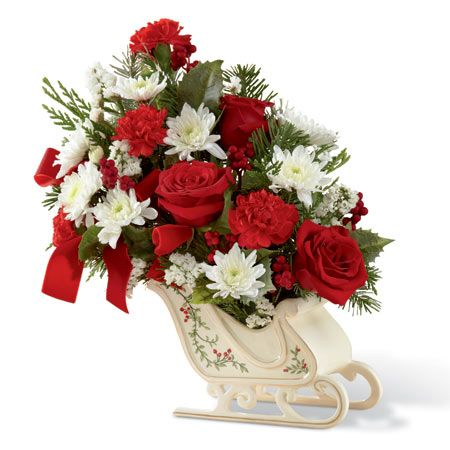 The Winter Sleigh Ride Bouquet is a one of a kind Christmas flower gift. Delivered in a keepsake sled, this is a unique gift from SendFlowers.com.
