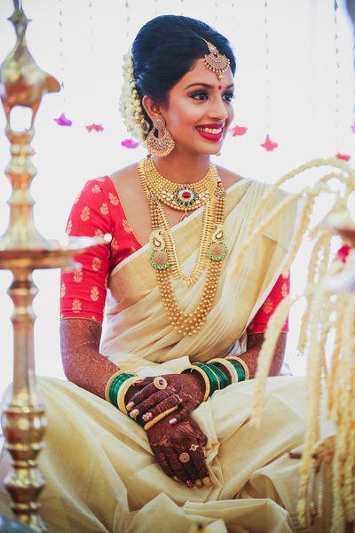 c21584a904592a Gold Indian bridal jewelry.Temple jewelry. Jhumkis. Cream silk kanchipuram  sari.Braid with fresh jasmine flowers. Tamil bride. Telugu bride. Kannada  bride.
