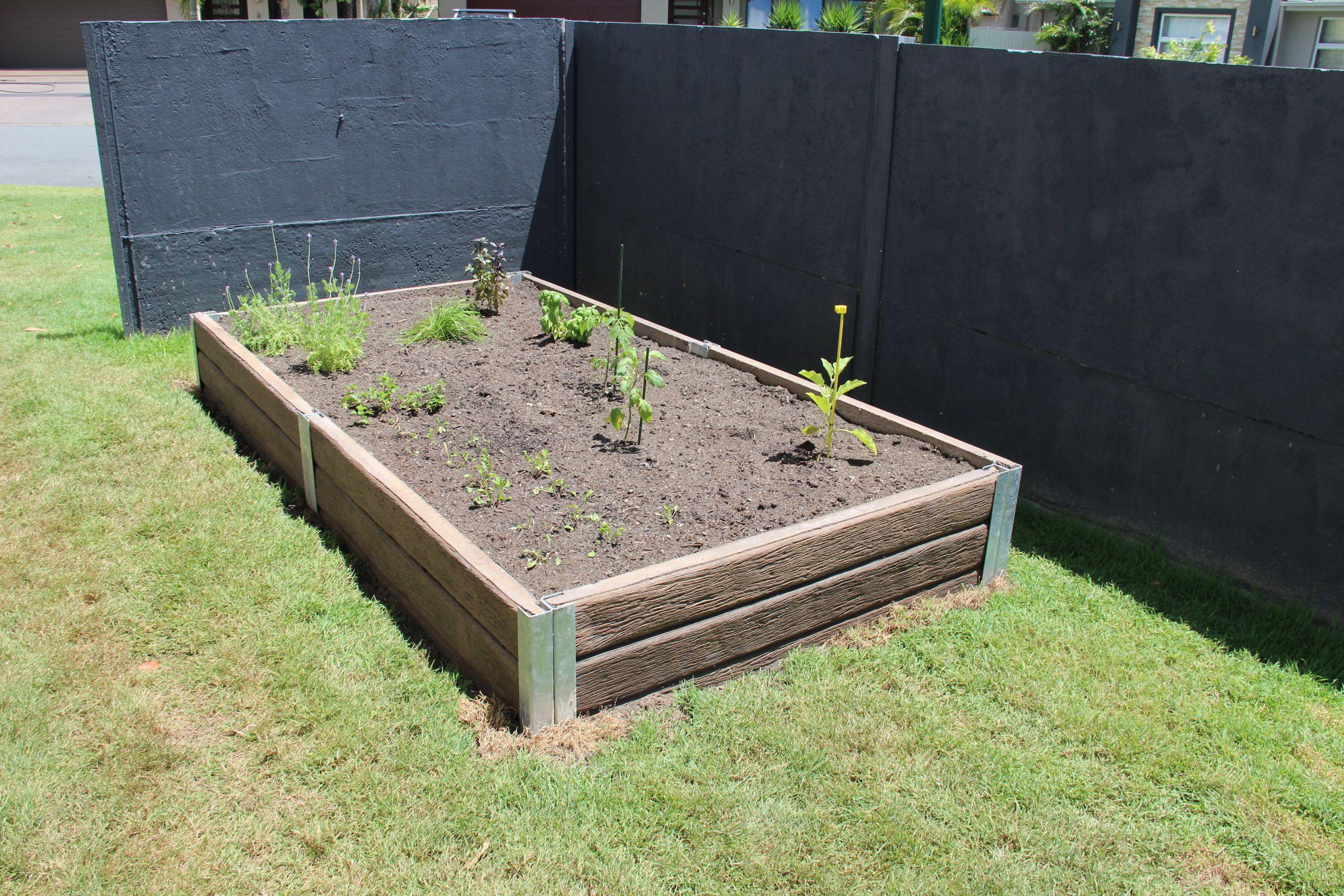 Ridgi Ironbark Concrete Sleepers Steel Posts Used To Create A Veggie Patch For More Information Concrete Sleeper Retaining Walls Backyard Concrete Sleepers