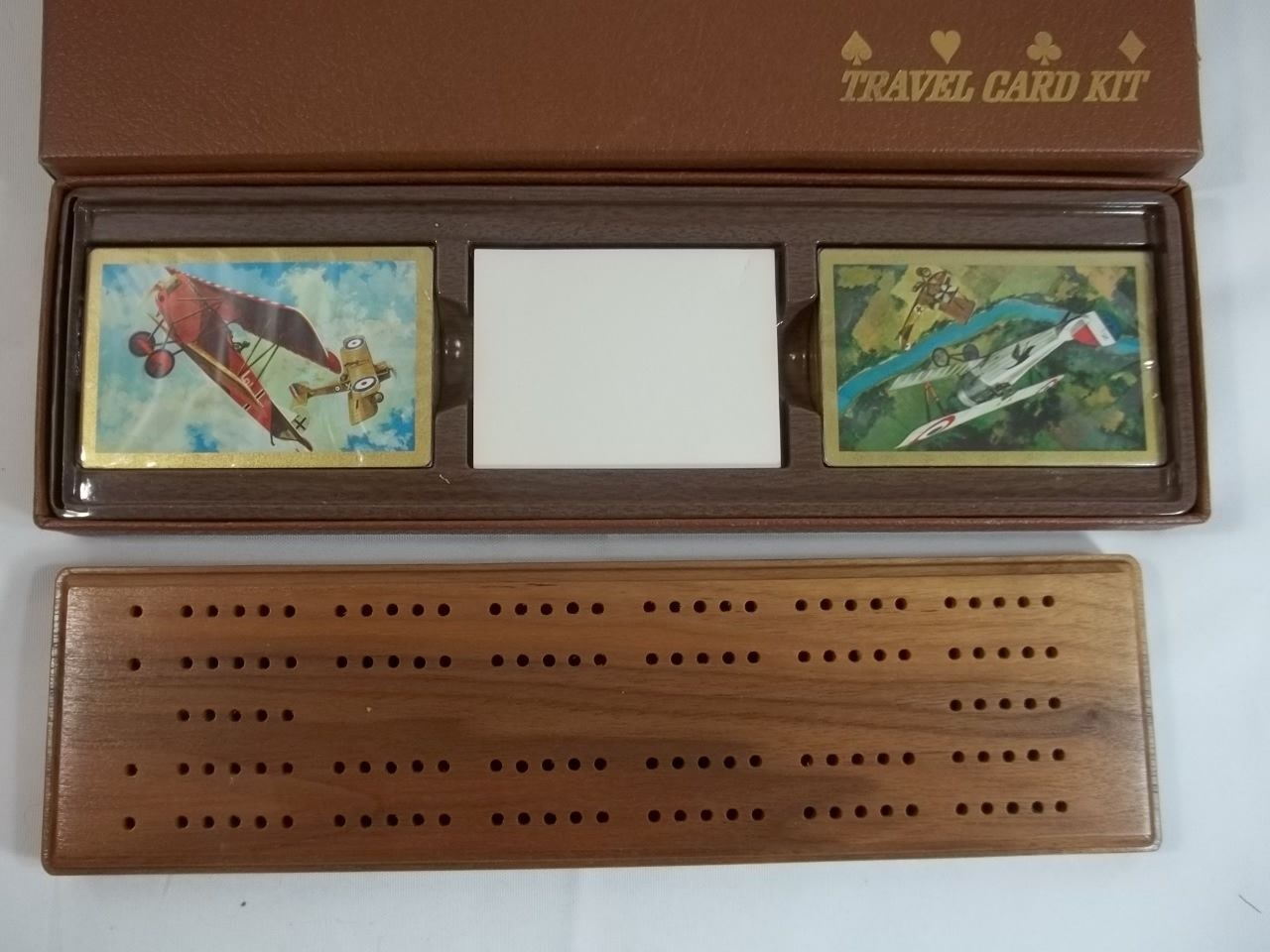 Travel cribbage board in case unopened cards airplanes