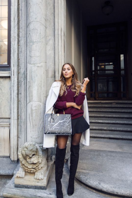 838864af48d Kenza Zouiten wears her over the knee boots with a black mini skirt and  plum coloured knit sweater. Boots  Novita from Scoritt