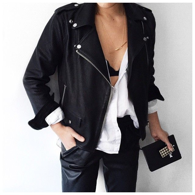 Pairing a leather moto jacket with leather pants and a white cotton shirt. We love this look.