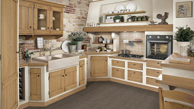Parete con mattoni a vista in una cucina muratura rustica - Ante per cucina in muratura ...