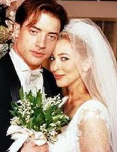 newly married husband and wife: Brendan Fraser and Afton at their wedding ceremony