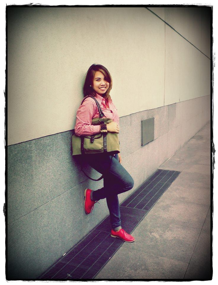 Red checkered polo, red oxfords, olive green bag