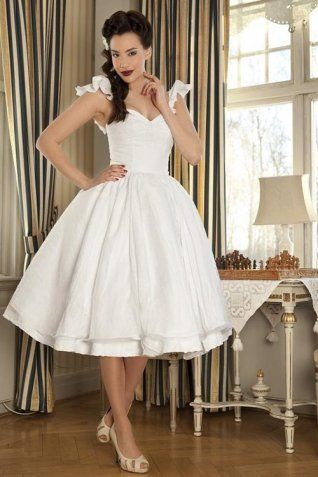 Wedding dress with sweetheart neckline and tea length. The shoulder straps are beautifully ruffled. The full skirt is gathered at waist and double-layered. Free made-to-measurement service for any size. Available colors seen as in Color Options.