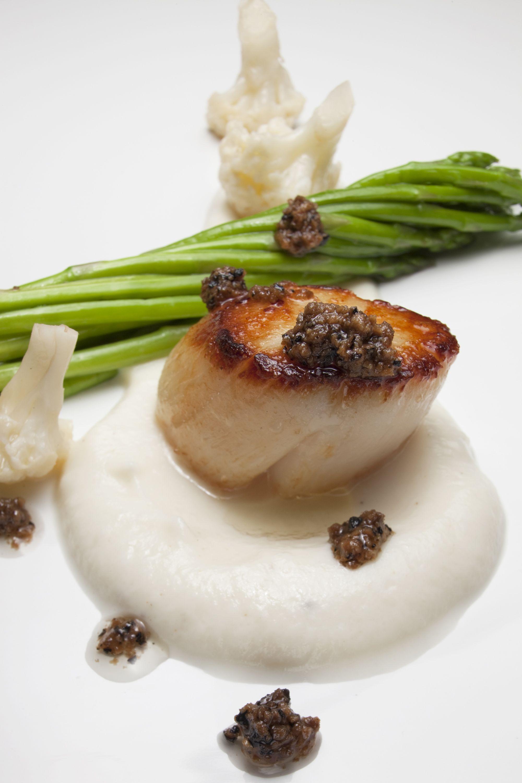 Cauliflower puree with Buffalo Truffle Butter, roasted scallops and little asparagus.  http://www.appenninofunghietartufi.it/wp-content/uploads/2013/06/june2013.pdf