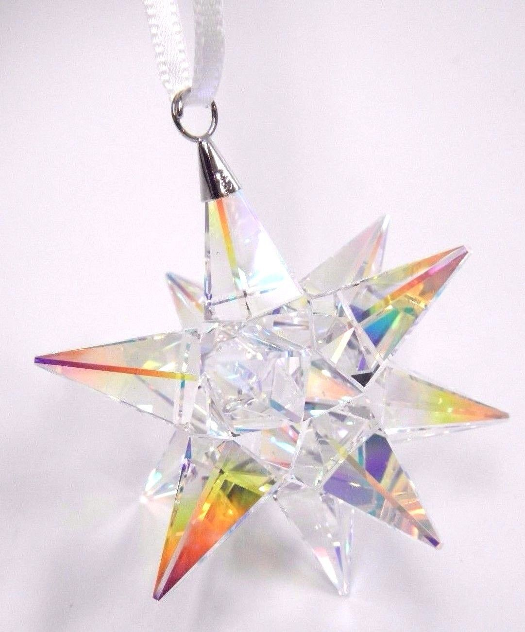 794b4a42ca1 STAR ORNAMENT, AURORA BOREALIS CRYSTAL This stunning star ornament will add  a captivating, iridescent sparkle to your holiday décor. It is coated wit.