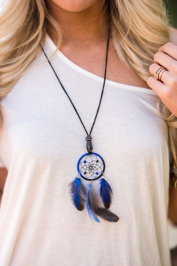 7ea00666e378 Dream a little dream with these miniature dreamcatcher necklaces. Adorned  with a small ceramic bead at the base. - Slip on style