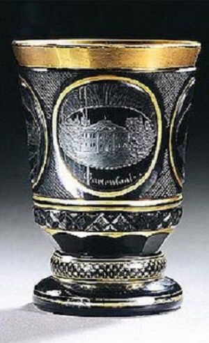 A South Bohemian engraved and gilt black `Hyalith' beaker, circa 1830, the waisted...