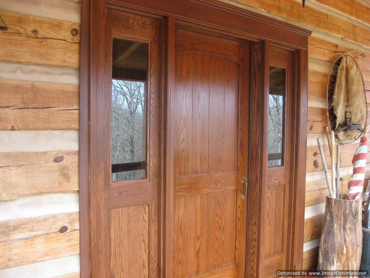 Red oak entry door with two side lites custom made by homestead woodworking llc