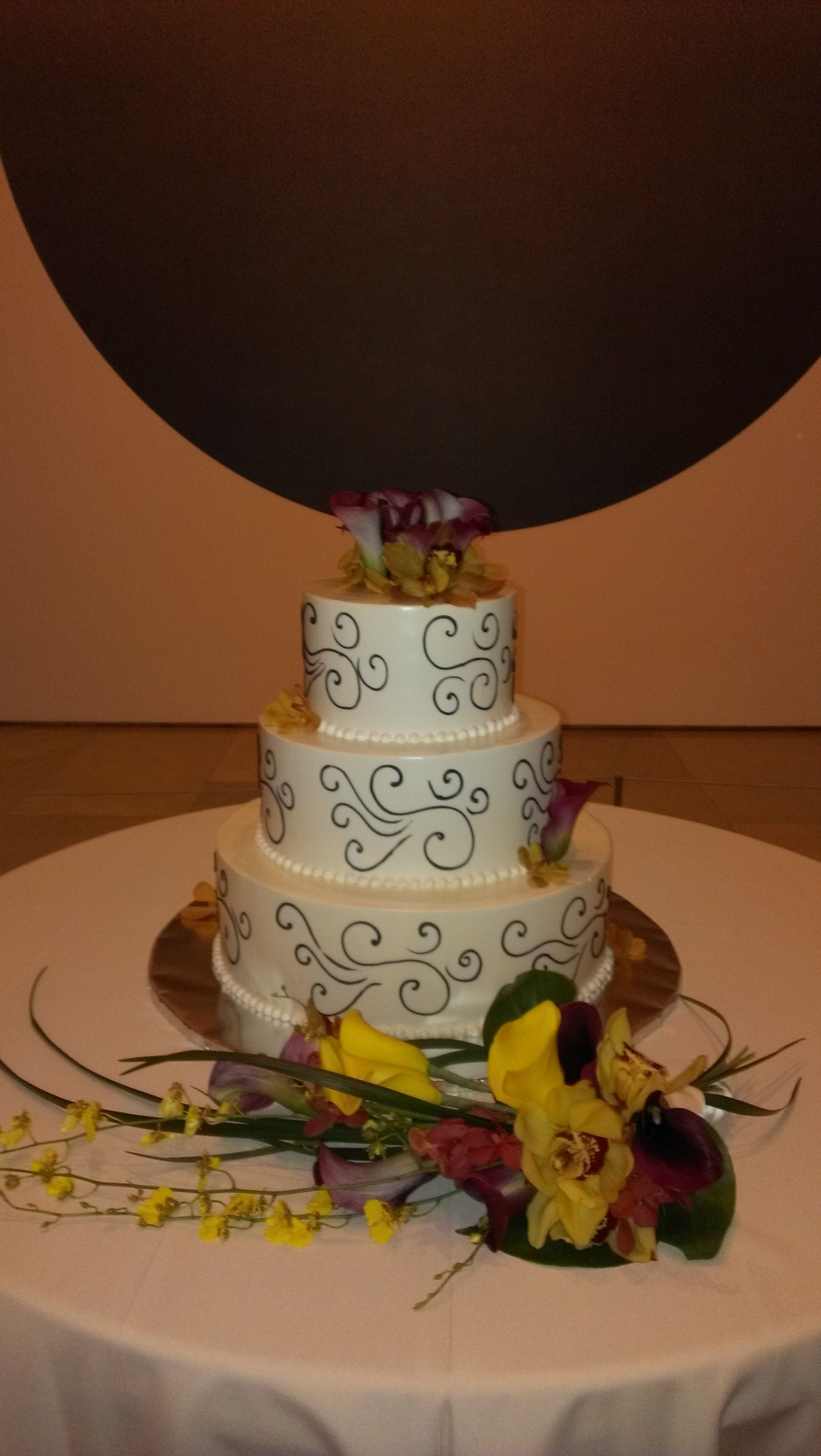 Contemporary wedding cake with original art backdrop at Phoenix Art Museum.  Florals by Karen Bever of Boka Event Florals. Cake by Honeymoon Sweets.