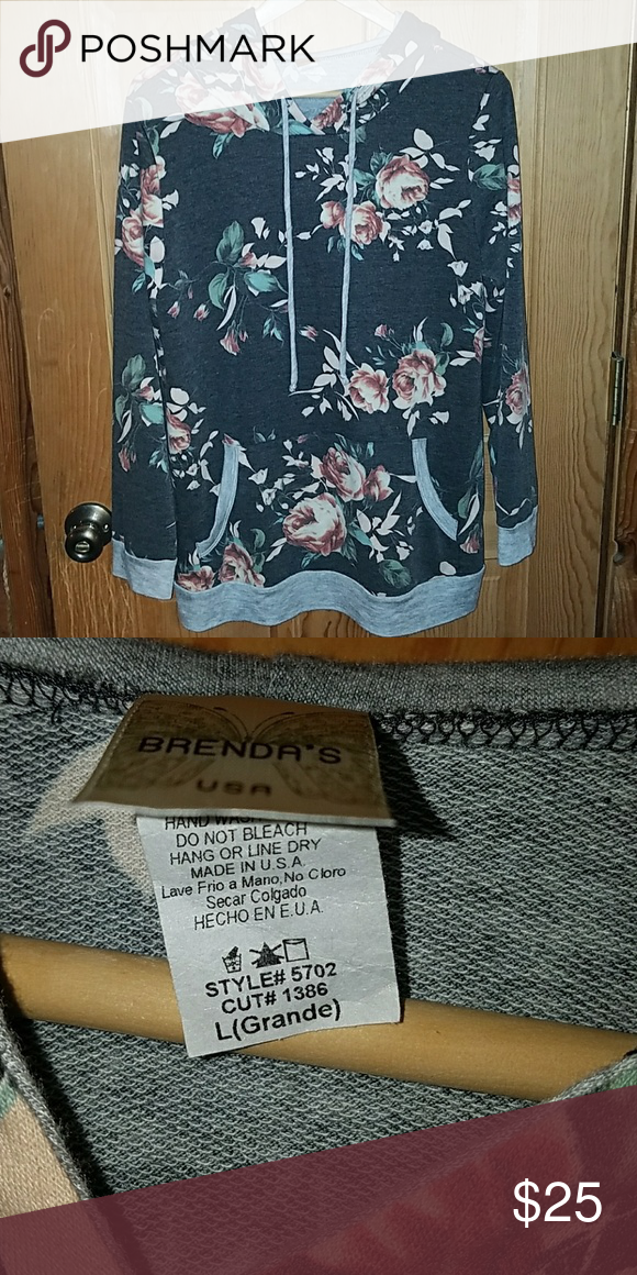 Floral hoodie It says size large but I would say it's more an extra large brendas Tops Sweatshirts & Hoodies