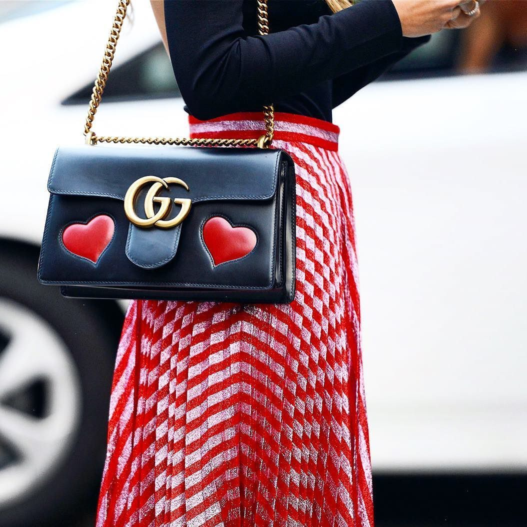 8a301764ed9 Gucci shiny leather shoulder bag with embedded red hearts. Antiqued golden  hardware. Sliding chain strap can be doubled