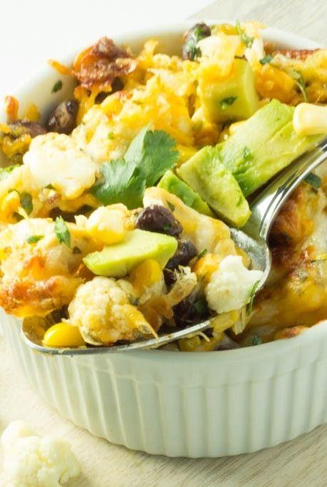 Cheesy Tex-Mex cauliflower with chicken, black beans, corn, cilantro and avocado