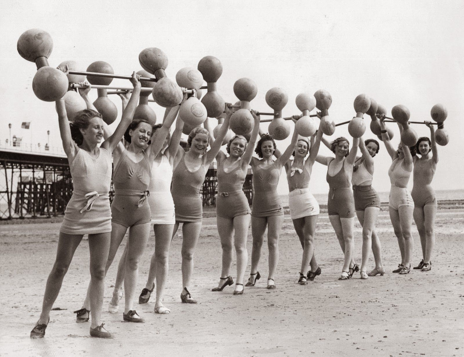 Vintage women exercising lifting not dumbbells they are lifting barbells folks