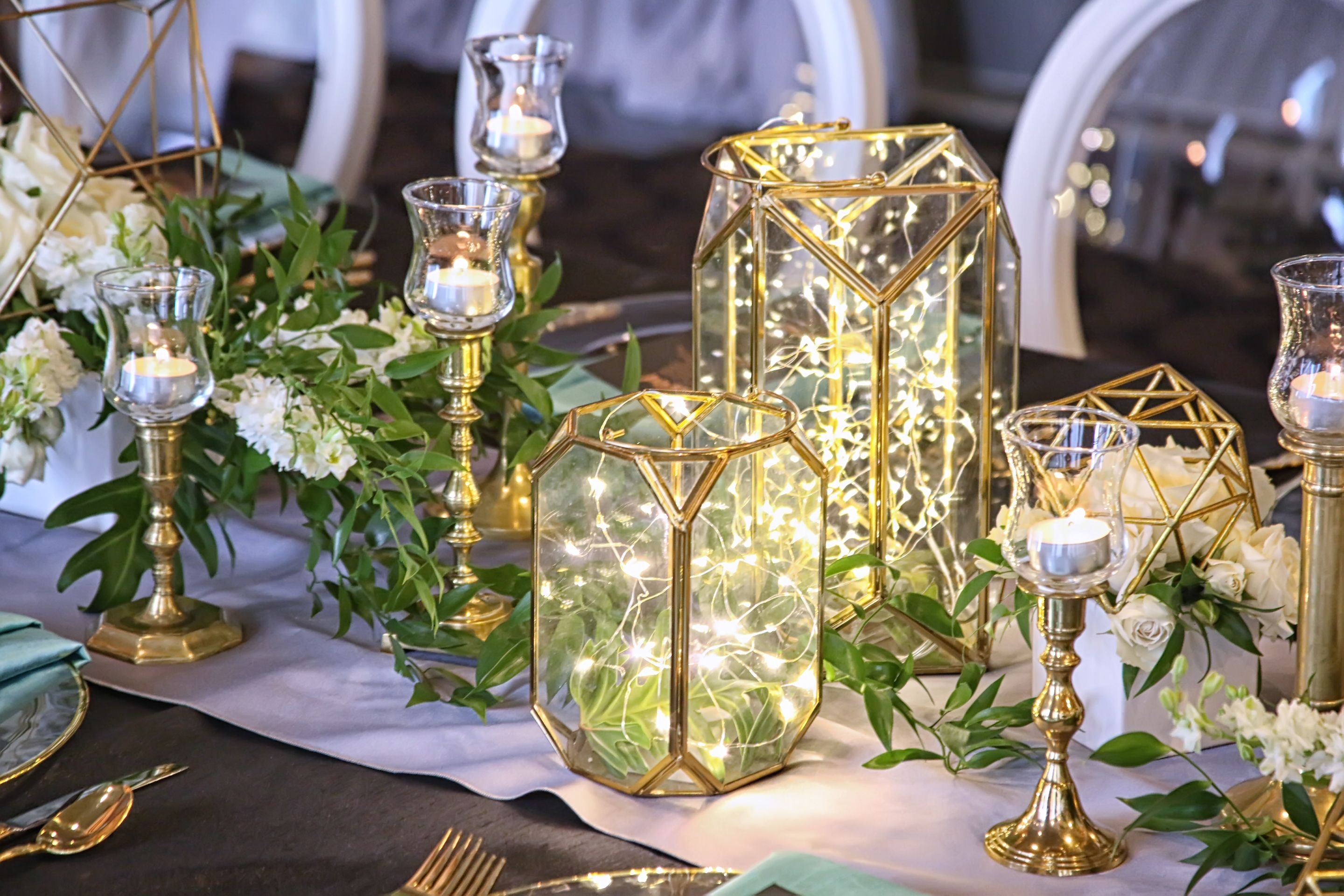 table centerpiece design and floral by Lana with FairbanksFlorist.net, photo ArtFaulkner.com I used Geometric Figurines as armatures for the floral designs and geometric glass lanterns.