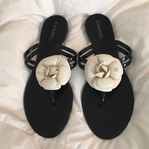 cf57fa4631af Chanel camellia jelly flip flop Black PVC flip flops with classic Chanel  camellia near thong strap. Gold Chanel