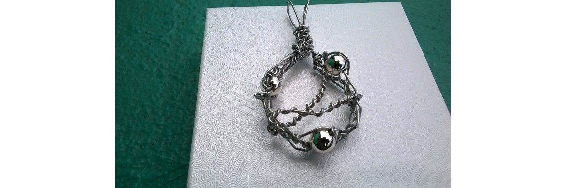 This is not your ordinary etsy jewelry,it's  a twisted circular silver balls pendant (suns pendant) from Sparkle Memoriez.
