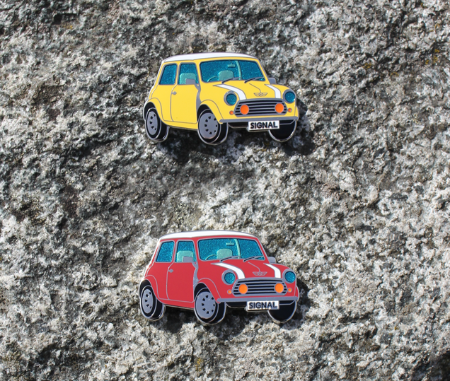 This two sided coin features classic colors and translucent enamels to give a very realistic look. There is even raised metal to give extra detail behind the window. This Classic Mini is sure to become a Classic Geocoin!
