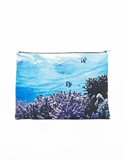 Dive into summer with this totally essential neoprene clutch featuring vibrant ocean prints all over