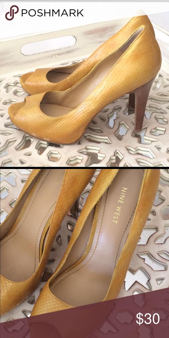Nine West Golden Yellow Leather Peep Toe Textured yellow leather peep toe  with wood grain heel. Heel is 4.5