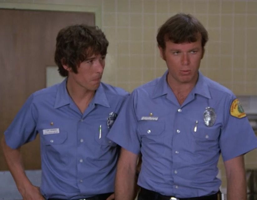 """Johnny Gage (Randolph Mantooth) and Roy DeSoto (Kevin Tighe), """"Surprise """""""