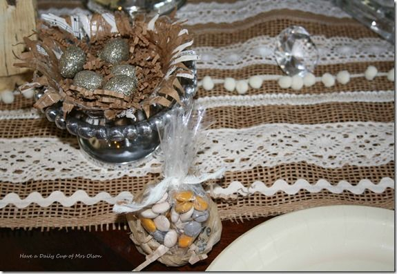 table runner with laces and trims on burlap