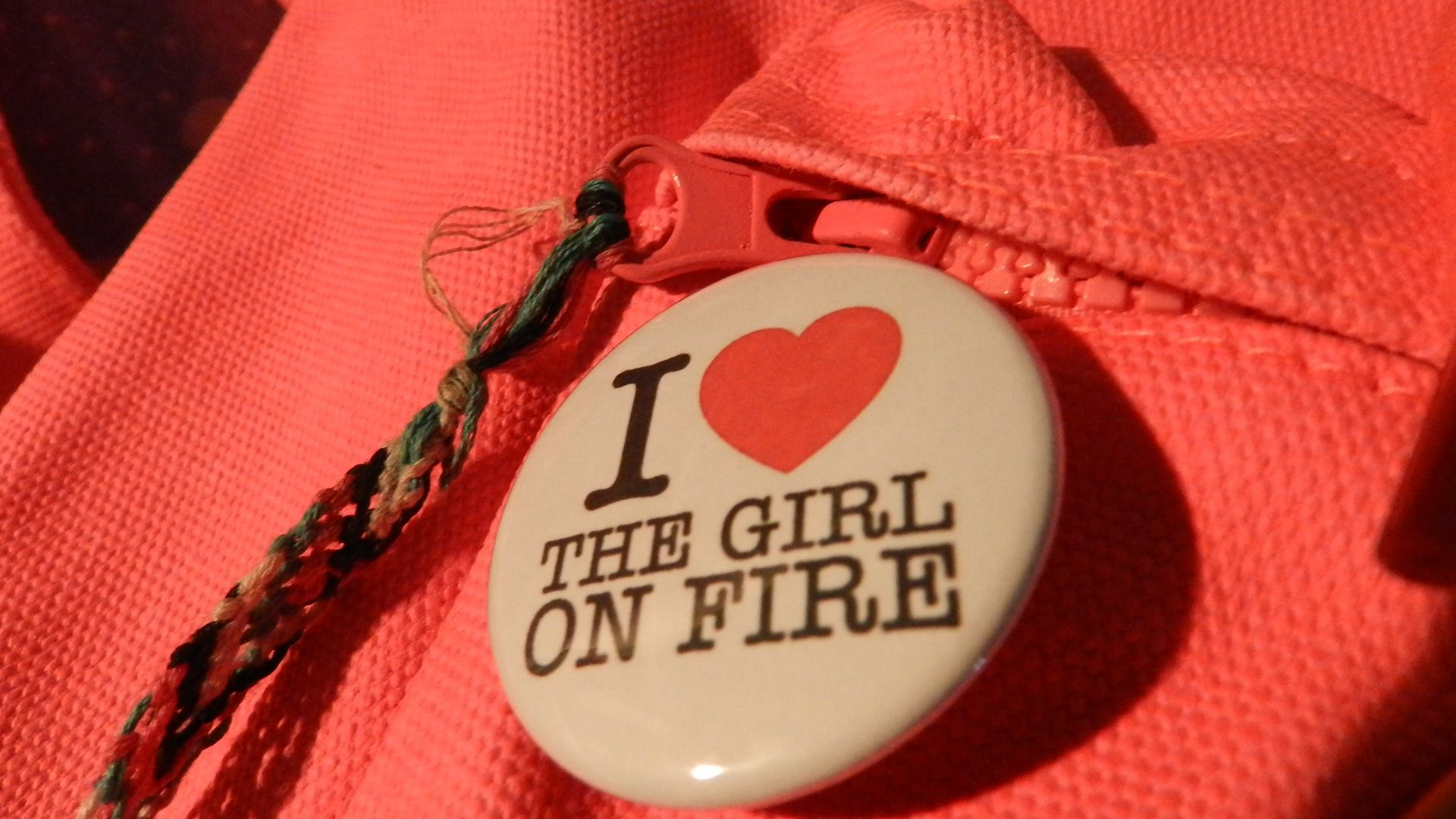 my i heart the girl on fire button just came in about a week ago.   love etsy!