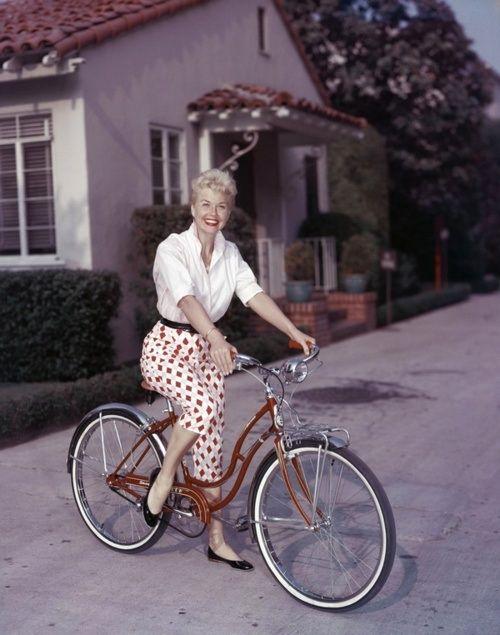 Doris Day - having a fun day riding her bike! Cute outfit