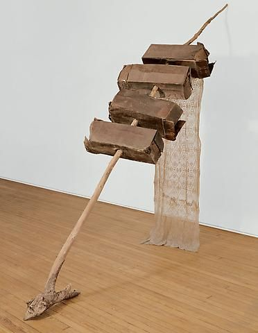 Rauschenberg:Untitled (Venetian), 1973, Cardboard, wood branch, and lace curtain 93 x 28 x 108 inches (236.2 x 73.7 x 274.3 cm)
