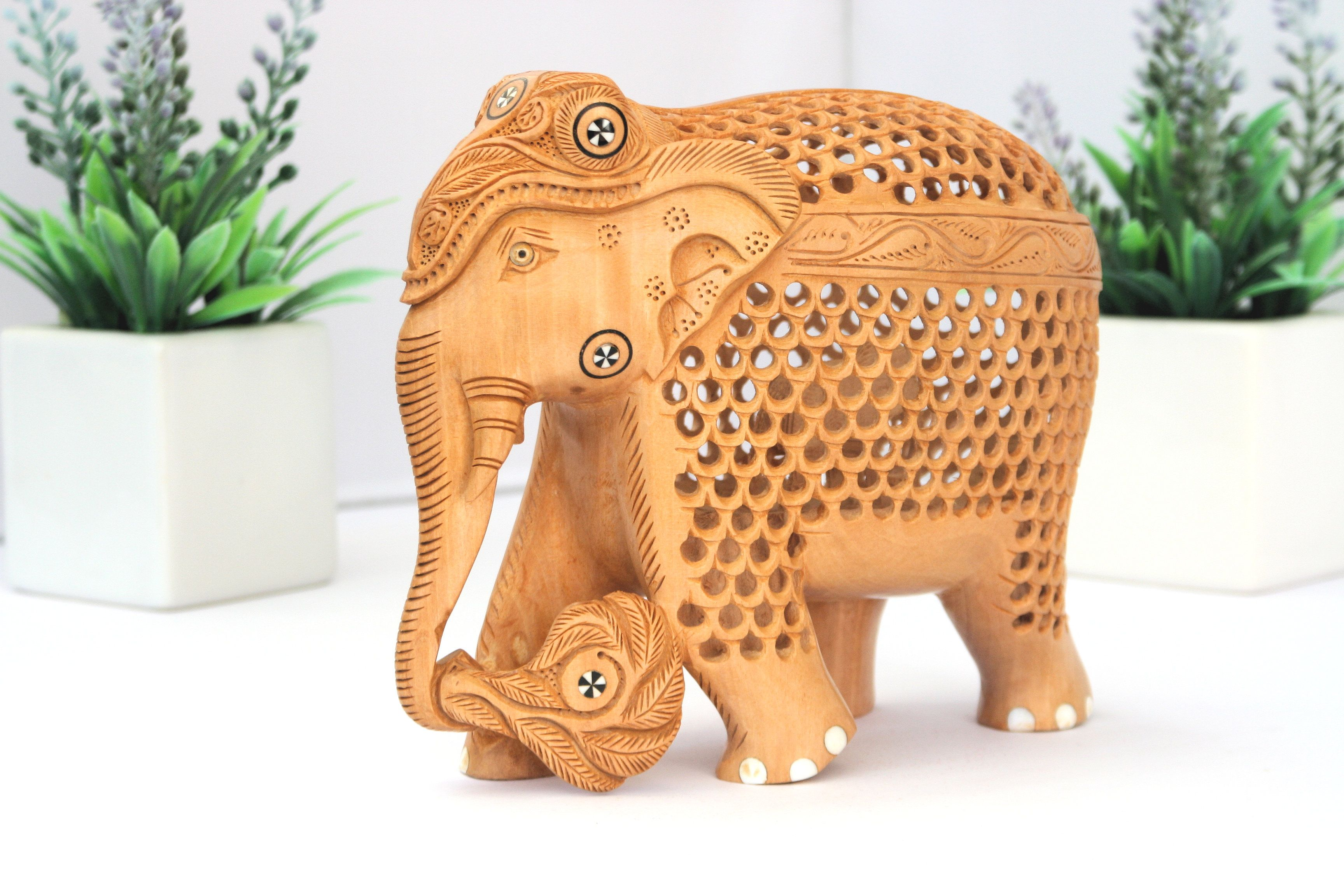 Hand carved Lattice style wooden elephant with baby elephant